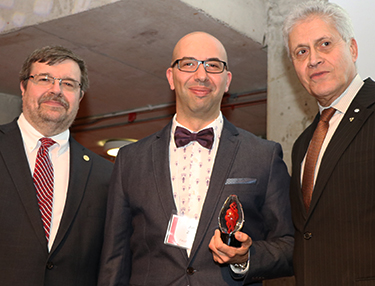 Amro (middle) with Vice President of Research and Innovation, Dr. Rob Haché (left) and YU President Mamdoh Shoukir